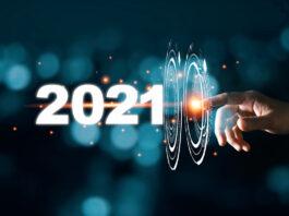 A hand touches a virtual interface rippling forward into 2021.
